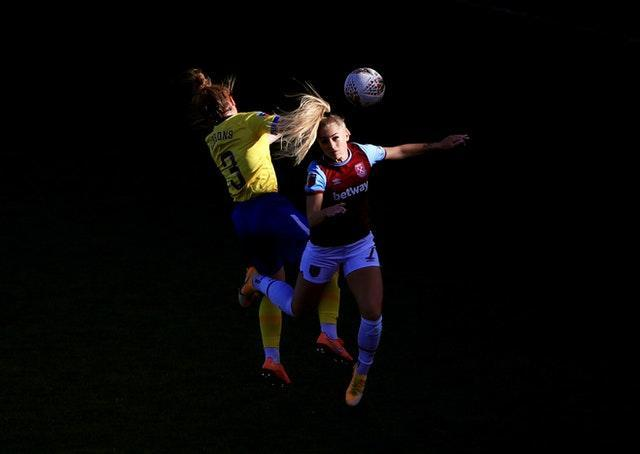 Brighton's Felicity Gibbons, left, and Alisha Lehmann of West Ham compete for a header during a Women's Super League match in November. Rianna Jarrett's second-half finish earned a 1-0 away win for Albion at Chigwell Construction Stadium in Dagenham