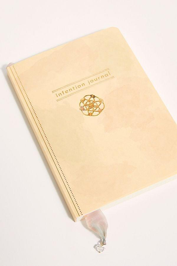 <p>When I need a moment to recenter myself, I like to write. Since I spend so much time on the computer, I like taking pen to paper with this <span>Intention Journal</span> ($36).</p>