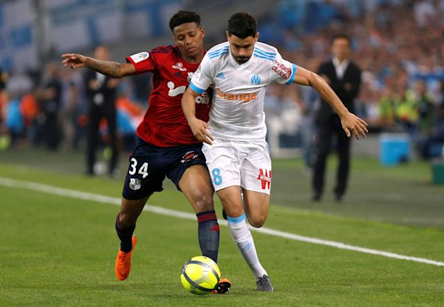 Soccer Football - Ligue 1 - Olympique de Marseille vs Amiens SC - Orange Velodrome, Marseille, France - May 19, 2018 Marseille's Morgan Sanson in action with Amiens' Bongani Zungu REUTERS/Philippe Laurenson