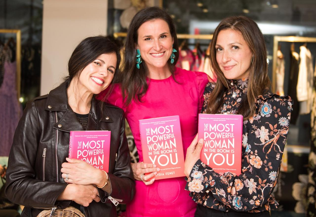 <p>Amidst some shopping, guests show off their signed copies of Lydia's new book, <em>The Most Powerful Woman in the Room is You</em>.  </p>