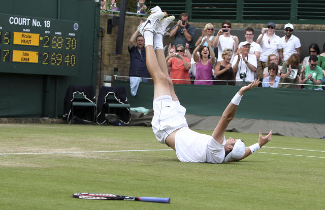 FILE - In this June 24, 2010, file photo, John Isner reacts as he defeats France's Nicolas Mahut, in their men's singles match at the All England Lawn Tennis Championships at Wimbledon. (AP Photo/Alastair Grant, Pool, File)