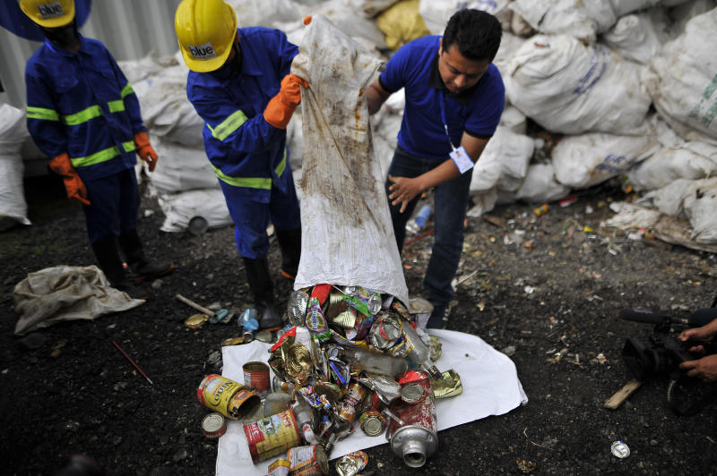 Staff and Workers from the recycle company Blue Waste 2 Value showing the waste garbage's towards media collected from Mount Everest and Base Camp in Kathmandu, Nepal on Wednesday, June 05, 2019. Clean-up Campaign 2019 on Mount Everest removes 24,000lbs of rubbish and four dead bodies. (Photo by Narayan Maharjan/NurPhoto via Getty Images)
