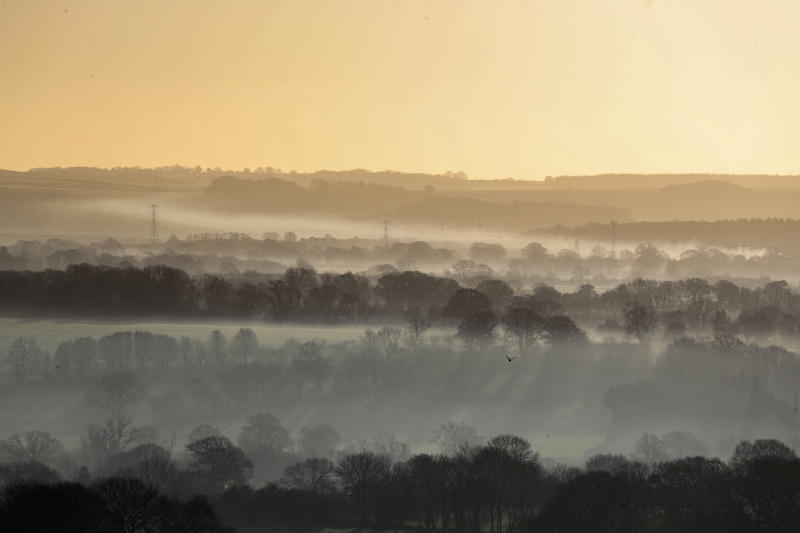 Early morning mist over fields near Pewsey in Wiltshire as plunging temperatures are expected across the country this weekend with the mercury predicted to dip as low as -6C.