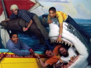 People being eaten by a fake shark