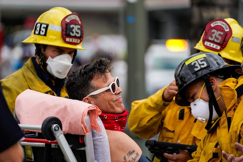 Steve-O is checked out by firefighters after being brought down from a Hollywood billboard on Thursday.