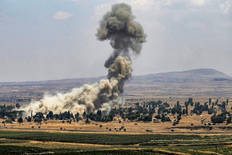A picture taken from the Israeli-annexed Golan Heights shows smoke rising across the border area in Syria's southwestern Quneitra province on July 22, 2018 (AFP Photo/JALAA MAREY)