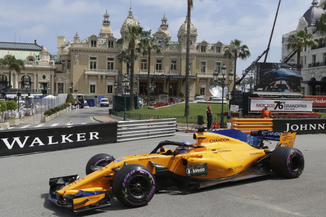 FILE - In this May 24, 2018, file photo, McLaren driver Fernando Alonso of Spain steers his car past the casino during the second practice session for the Monaco Formula One Grand Prix at the Monaco racetrack, in Monaco. McLaren will put a car on track at Indianapolis Motor Speedway for the first time since 1976 when Fernando Alonso tests Wednesday, April 24, 2019. Alonso is trying to win motorsports version of the Triple Crown, while the famed manufacturer is considering a return to IndyCar competition. (AP Photo/Claude Paris, File)