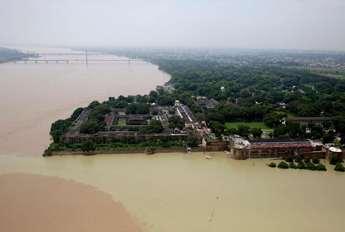 <p>The Flooded river Ganges is seen from a helicopter in Allahabad, India, Friday, Aug. 26, 2016. (AP Photo/Rajesh Kumar Singh)</p>