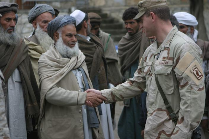 Michael Breen, right, with Afghans in Kunar province, Afghanistan, in 2006.