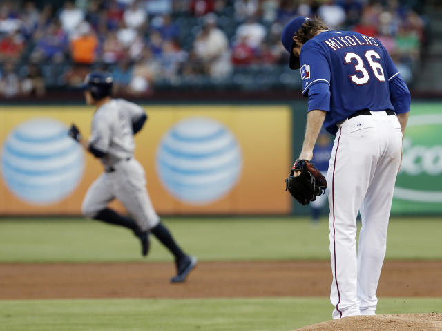 Texas Rangers starting pitcher Miles Mikolas (36) looks on as Tampa Bay Rays' Brandon Guyer, background, rounds the bases after hitting a two-run home run during the second inning of a baseball game, Wednesday, Aug. 13, 2014, in Arlington, Texas. (AP Photo/Brandon Wade)