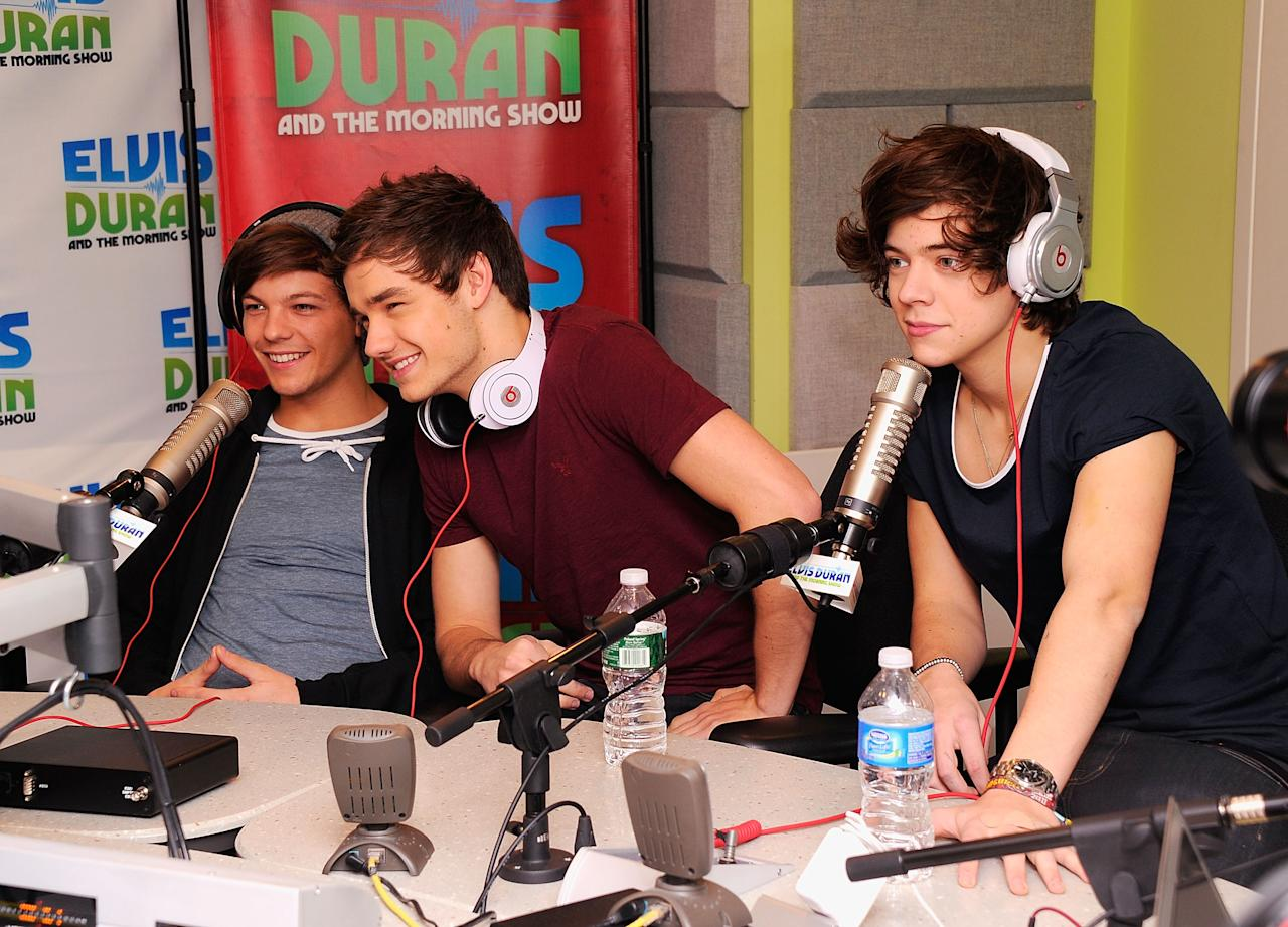 """NEW YORK, NY - MARCH 14:  One Direction band members (L-R) Louis Tomlinson, Liam Payne and Harry Styles visit """"The Elvis Duran Z100 Morning Show"""" at Z100 Studio on March 14, 2012 in New York City. The interview was recorded and aired on March 16, 2012.  (Photo by Andrew H. Walker/Getty Images)"""