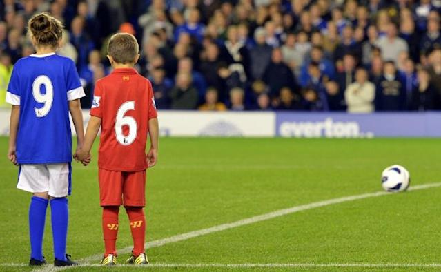 Child mascots were part of a Hillsborough commemoration, but Liverpool said that, because of the coronavirus, was no longer going to have youngsters escort the team on to the field (AFP Photo/PAUL ELLIS)