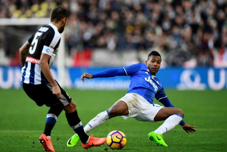 Udinese's defender Danilo Larangeira (L) vies with Juventus' defender Alex Sandro Lobo Silva during the Italian Serie A football match Udinese vs Juventus at the Dacia Arena Stadium in Udine on March 5, 2017