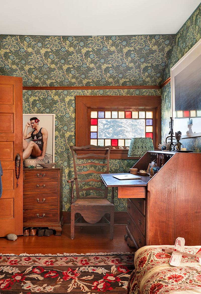 In the dressing room, a Doug Inglish print sits atop an 18th-century English chest. Morris & Co. wallpaper; late-18th century American desk.