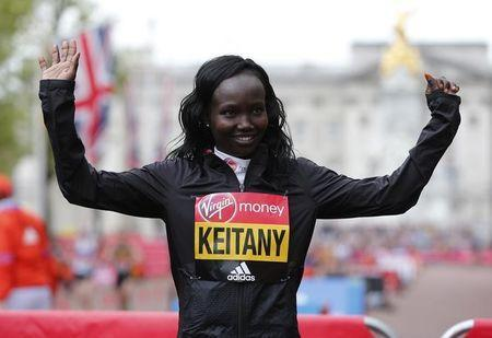 Kenya's Mary Jepkosgei Keitany celebrates winning the Women's Elite race. Action Images via Reuters / Matthew Childs Livepic