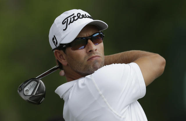 Adam Scott watches his tee shot on the second hole during the final round of the PGA Colonial golf tournament in Fort Worth, Texas, Sunday, May 25, 2014. (AP Photo/LM Otero)