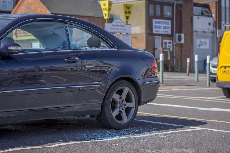 The car's window was smashed by a passer-by (SWNS)