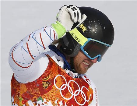 Second-placed Andrew Weibrecht of the U.S. reacts in the finish area after competing in the men's alpine skiing Super-G competition during the 2014 Sochi Winter Olympics at the Rosa Khutor Alpine Cente February 16, 2014. REUTERS/Leonhard Foeger