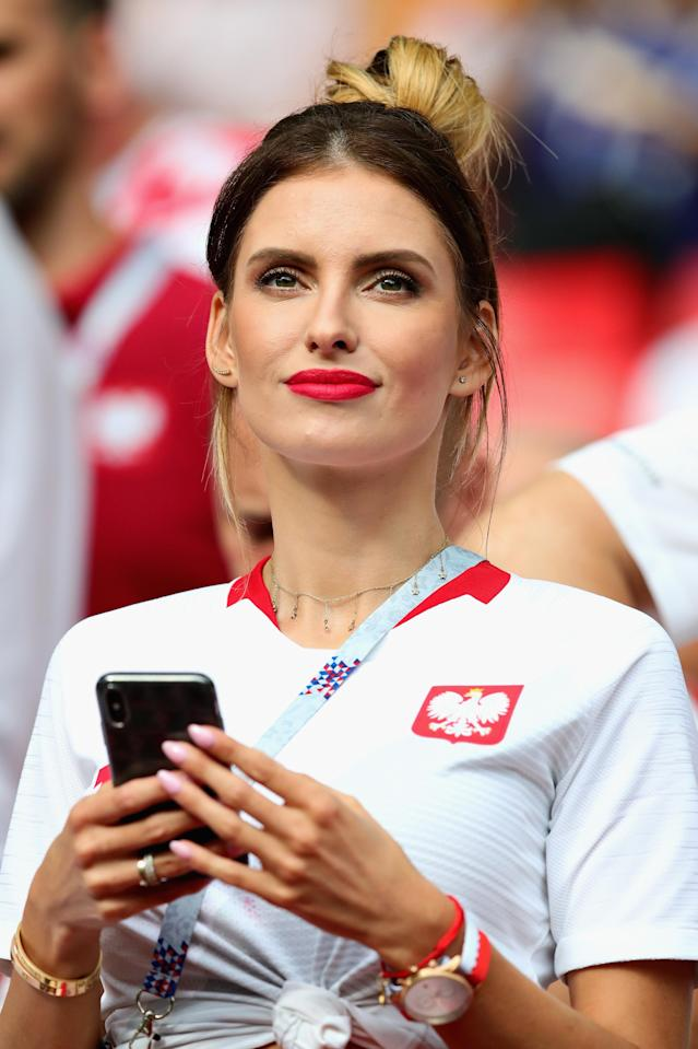 <p>Wife of Kamil Grosicki of Poland, Dominika Grosicka, looks on in the ground before the 2018 FIFA World Cup Russia group H match between Poland and Senegal at Spartak Stadium on June 19, 2018 in Moscow, Russia. (Photo by Chris Brunskill/Fantasista/Getty Images) </p>