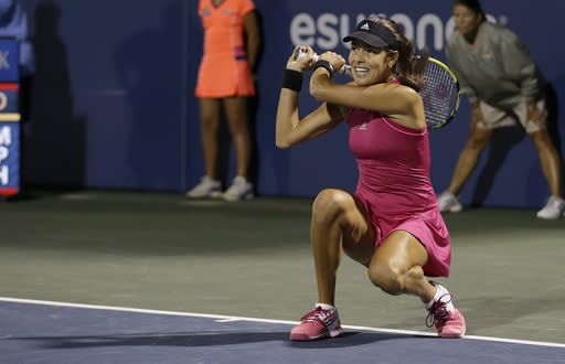 Ana Ivanovic, from Serbia, returns the ball to Serena Williams during the third set of their match in the Bank of the West Classic tennis tournament in Stanford, Calif., Friday, Aug. 1, 2014. Williams won 2-6, 6-3, 7-5. (AP Photo/Jeff Chiu)