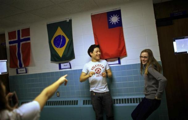 Davy Lin (C) , a foreign exchange student from Taoyuan, Taiwan and Lena Kraft, from Munich, Germany joke around in the hallways at Grant-Deuel School in Revillo, South Dakota February 13, 2012.