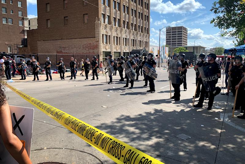 Image: Police form a line outside of the BOK Center before a rally hosted by President Donald Trump in Tulsa, Okla., on June 20, 2020. (Lauren Egan / NBC News)