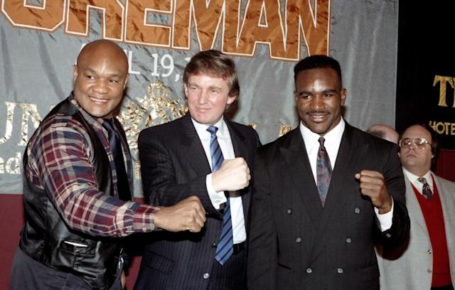 <p>George Foreman, Donald Trump and Evander Holyfield pose during a press conference to promote their upcoming fight on April 19, 1991 in Atlantic City, N.J. <i>(Photo: The Ring Magazine/Getty Images)</i> </p>