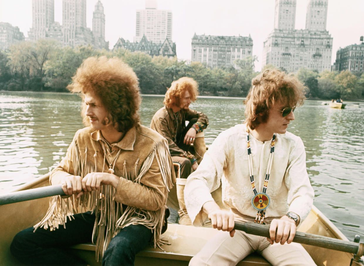 """Rock band """"Cream"""" pose for a portrait in a row boat in Central Park in November 1968 in New York City, New York. L-R: Eric Clapton, Ginger Baker, Jack Bruce. (Photo by Michael Ochs Archives/Getty Images)"""