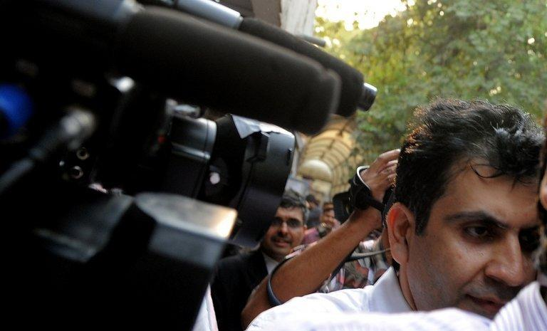 Managing Director of Unitech, Sanjay Chandra leaves after an appearance in a New Delhi court on April 15, 2011