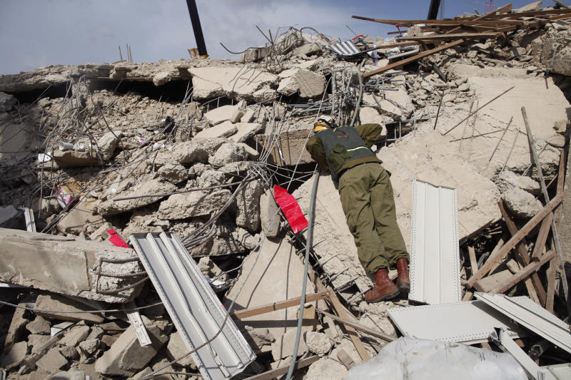 A member of the Israeli forces that have been sent to assist in the Ghana relief efforts, after a building collapsed in Accra, Ghana, Thursday, Nov. 8, 2012.  Authorities on Thursday blamed faulty construction for the collapse of the five-storey building in Ghana's capital that killed at least nine people and trapped some dozens of others as search and rescue efforts continue Thursday. (AP Photo/Gabriela Barnuevo)