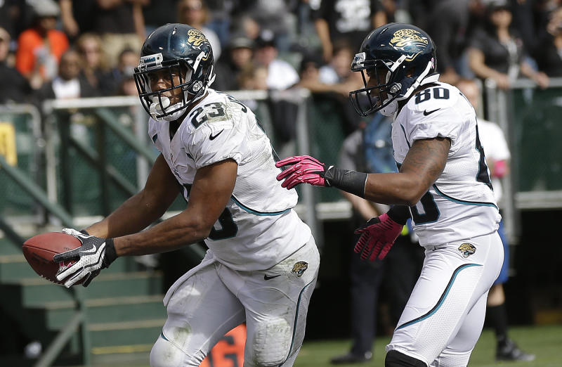 Jacksonville Jaguars running back Rashad Jennings (23) celebrates after scoring on a 5-yard touchdown run with wide receiver Mike Thomas (80) against the Oakland Raiders during the second quarter of an NFL football game, Sunday, Oct. 21, 2012, in Oakland, Calif. (AP Photo/Marcio Jose Sanchez)