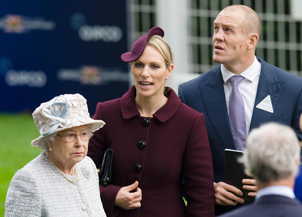 Britain's Queen Elizabeth II (L), Zara Phillips (C) and her husband former England rugby captain Mike Tindall (R) stand in the owner's ring at Ascot, England on October 20, 2012.  Frankel produced perhaps his finest performance to retain his unbeaten record with his 14th victory in the Group One Champion Stakes in what was his final race. The Henry Cecil-trained colt -- winning his 10th Group One race -- had stumbled out of the barrier but recovered his poise to power home to beat last year's winner Cirrus des Aigles by 1 3/4 lengths.AFP PHOTO / LEON NEAL        (Photo credit should read LEON NEAL/AFP via Getty Images)