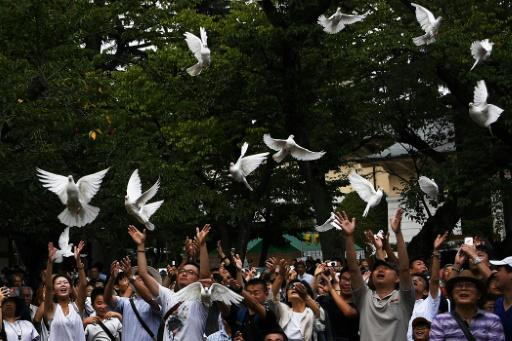 Doves are released as a symbol of peace at the Yasukuni shrine in Tokyo on the 74th anniversary of Japan's surrender in World War II