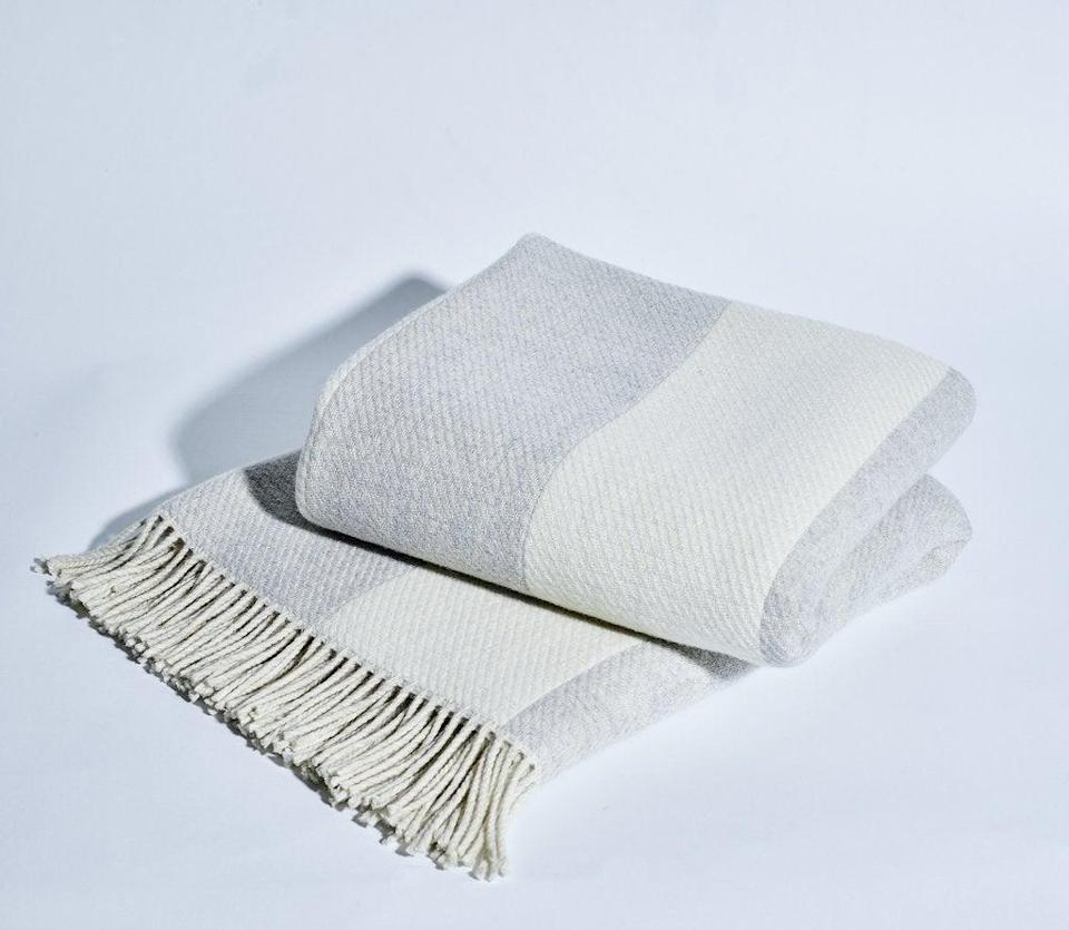 "<h2>Lambswool Striped Throw Blanket</h2><br>Lambswool and cashmere join cozy forces to create this striped blanket — ideal for the gift-giving season. <br><br><strong>Comfort Critics Say:</strong> ""Great blanket! Snowe has impressed me with the quality of products and customer service. Can't wait until I can explore more of their collection."" - <em>Justin R</em><br><br><strong><em><a href=""https://snowehome.com/collections/blankets-throws"" rel=""nofollow noopener"" target=""_blank"" data-ylk=""slk:Shop Snowe"" class=""link rapid-noclick-resp"">Shop Snowe</a></em></strong> <br><br><strong>Snowe</strong> Striped Throw Blanket, $, available at <a href=""https://go.skimresources.com/?id=30283X879131&url=https%3A%2F%2Fsnowehome.com%2Fproducts%2Fstriped-throw%3Fvariant%3D410050560020"" rel=""nofollow noopener"" target=""_blank"" data-ylk=""slk:Snowe"" class=""link rapid-noclick-resp"">Snowe</a>"