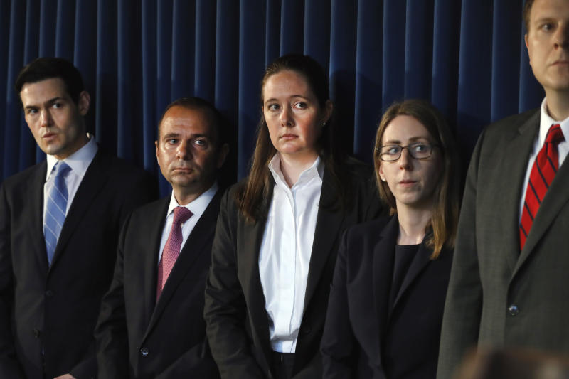 Assistant U.S. Attorney Maurene Comey, center, daughter of former FBI Director James Comey, listens during a news conference, in New York, Monday, July 8, 2019. Federal prosecutors announced sex trafficking and conspiracy charges against wealthy financier Jeffrey Epstein. Court documents unsealed Monday show Epstein is charged with creating and maintaining a network that allowed him to sexually exploit and abuse dozens of underage girls.(AP Photo/Richard Drew)