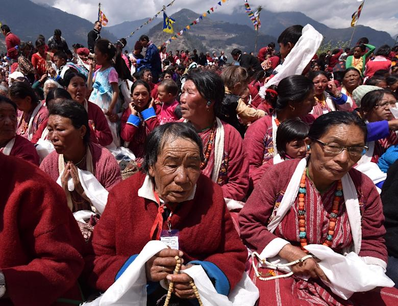 Buddhist followers listen during teachings by exiled Tibetan spiritual leader the Dalai Lama at the Sangdok Palri Monastery in the Tewang District near the Chinese border in India's north-eastern state of Arunachal Pradesh on April 7, 2017 (AFP Photo/Biju BORO)