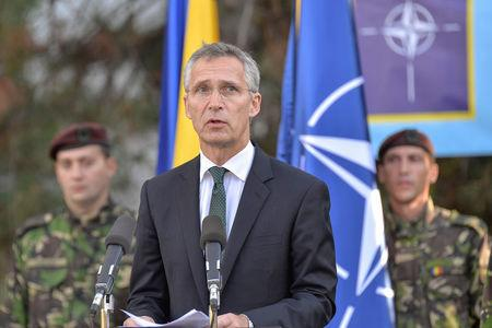 NATO Secretary-General Jens Stoltenberg delivers a speech as he reviews NATO multinational brigade in Craiova, Romania, October 9, 2017. Inquam Photos/Bogdan Danescu/via REUTERS