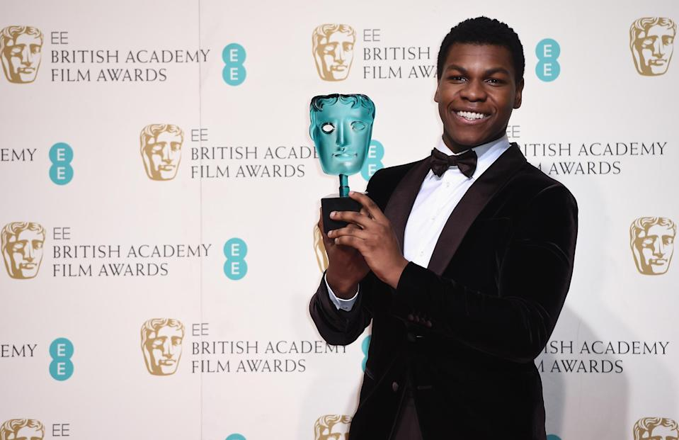 LONDON, ENGLAND – FEBRUARY 14: John Boyega poses with the EE Rising Star Award in the winners room at the EE British Academy Film Awards at the Royal Opera House on February 14, 2016 in London, England. (Photo by Ian Gavan/Getty Images)