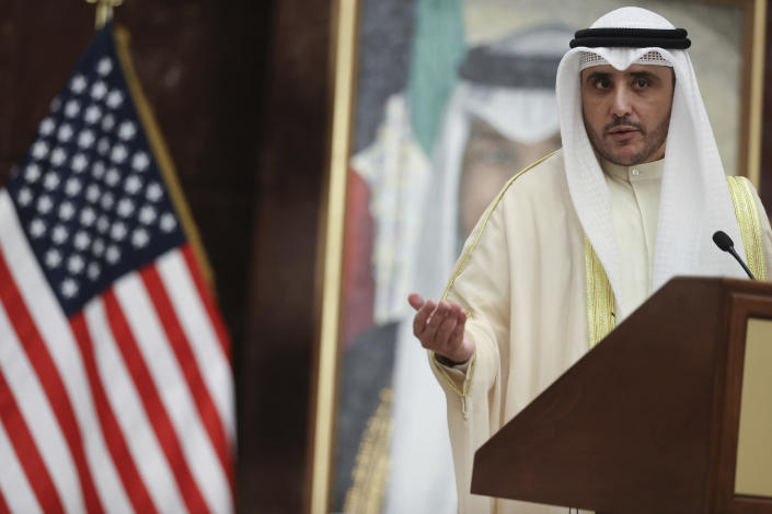 Kuwaiti Foreign Minister Sheikh Ahmad Nasser Al-Mohammad Al-Sabah participates in a news conference with U.S. Secretary of State Antony Blinken at the Ministry of Foreign Affairs in Kuwait City, Kuwait, Thursday, July 29, 2021. (Jonathan Ernst/Pool via AP)