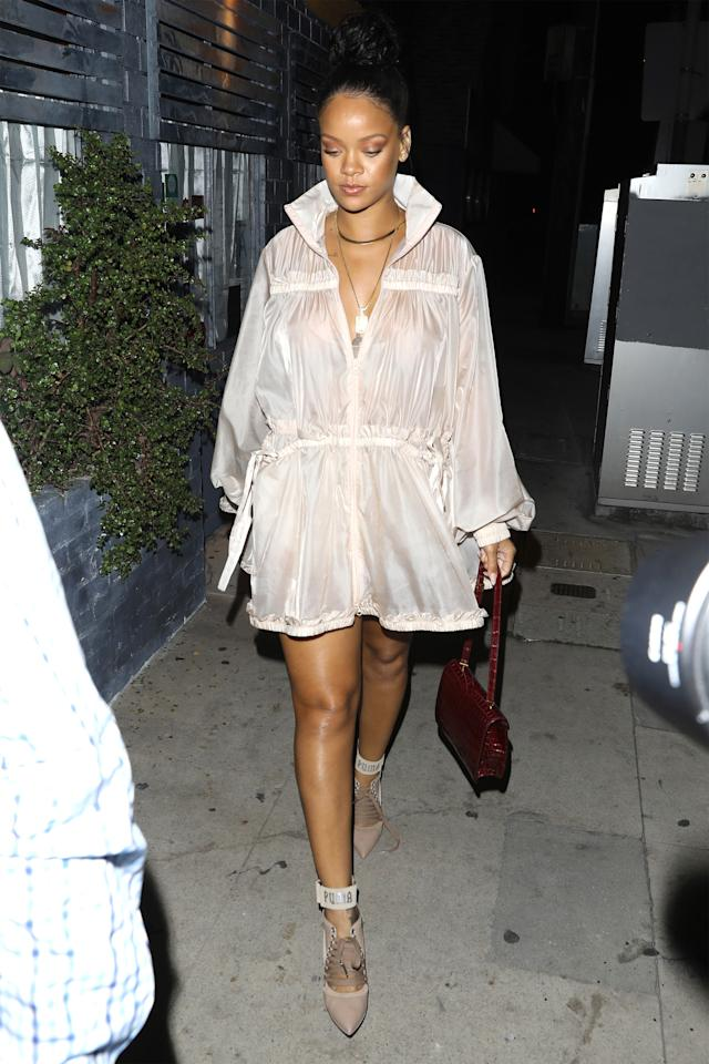 <p>In a sheer raincoat, Fenty x Puma sandals and holding a red python-skin purse while out in LA. </p>