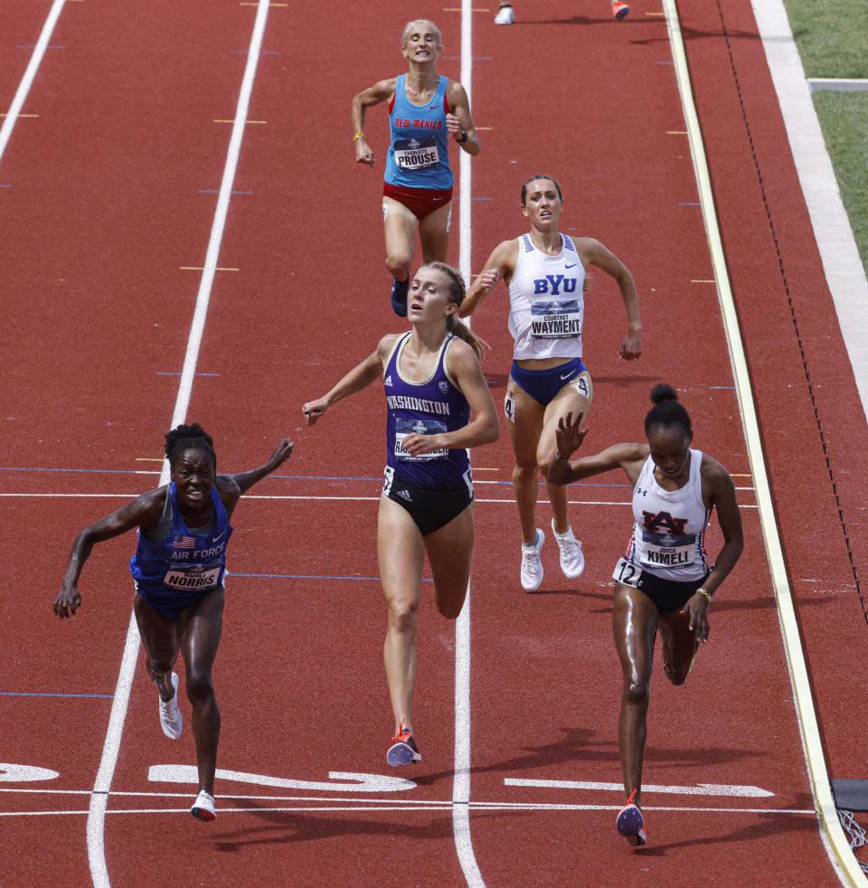Air Force's Mahala Norris, left, narrowly edges out Auburn's Joyce Kimeli in the women's steeplechase during the NCAA Division I Outdoor Track and Field Championships, Saturday, June 12, 2021, at Hayward Field in Eugene, Ore. (AP Photo/Thomas Boyd)