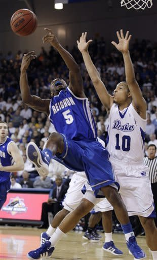 Creighton guard Josh Jones (5) is fouled by Drake forward Jeremy Jeffers (10) while driving to the basket during the first half of an NCAA college basketball game, Wednesday, Jan. 25, 2012, in Des Moines, Iowa. (AP Photo/Charlie Neibergall)