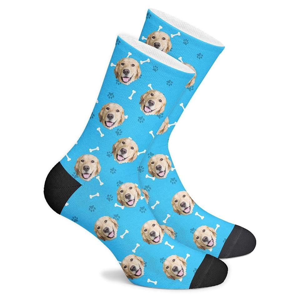 """<p><strong>Go Pup Socks</strong></p><p>gopupsocks.com</p><p><strong>$24.95</strong></p><p><a href=""""https://gopupsocks.com/product/custom-pupsocks/?attribute_pa_styles=blue&adTribesID=21f85665197d338957c816e357a2b606%7Cadtribes%7C296028&gclid=CjwKCAjw4rf6BRAvEiwAn2Q76mEVici5nvbh7lT3cpH-y_o-VGtGrCU1tqtoYgROEyZvayaJh_9gshoC5eUQAvD_BwE"""" rel=""""nofollow noopener"""" target=""""_blank"""" data-ylk=""""slk:SHOP IT"""" class=""""link rapid-noclick-resp"""">SHOP IT</a></p><p>I don't have anything to add about these socks. The image of this exquisite creation does all the talking for me. The perfect Christmas present, or the perfect Christmas present? </p>"""