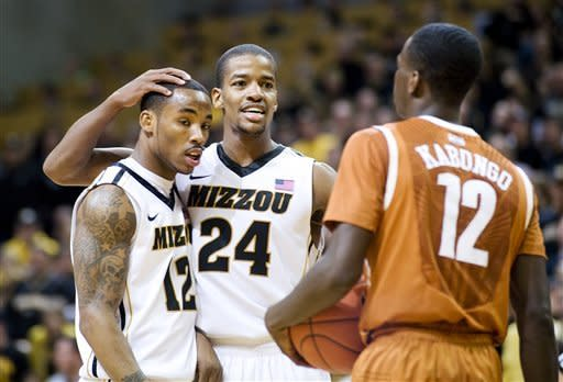 Missouri's Kim English, center, celebrates with teammate Marcus Denmon, left, as Texas' Myck Kabongo, right, looks on late in the second half of an NCAA college basketball game Saturday, Jan. 14, 2012, in Columbia, Mo. Missouri won the game 84-73. (AP Photo/L.G. Patterson)
