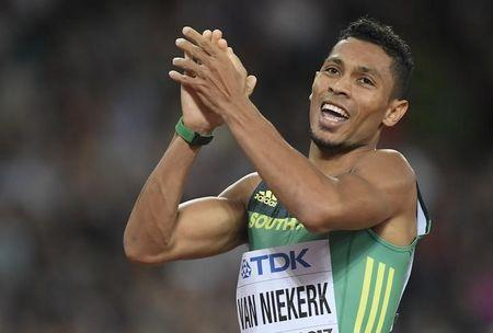Wayde van Niekerk of South Africa reacts after winning the silver. REUTERS/Toby Melville
