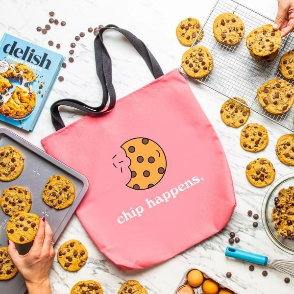 """<p>delish.com</p><p><strong>$25.00</strong></p><p><a href=""""https://shop.delish.com/products/chip-happens-tote"""" rel=""""nofollow noopener"""" target=""""_blank"""" data-ylk=""""slk:BUY NOW"""" class=""""link rapid-noclick-resp"""">BUY NOW</a></p><p>Chip happens, but at least you have this cute tote to carry with you everywhere you go. </p><p><strong>See more on <a href=""""https://shop.delish.com/"""" rel=""""nofollow noopener"""" target=""""_blank"""" data-ylk=""""slk:shop.delish.com"""" class=""""link rapid-noclick-resp"""">shop.delish.com</a>. </strong></p>"""