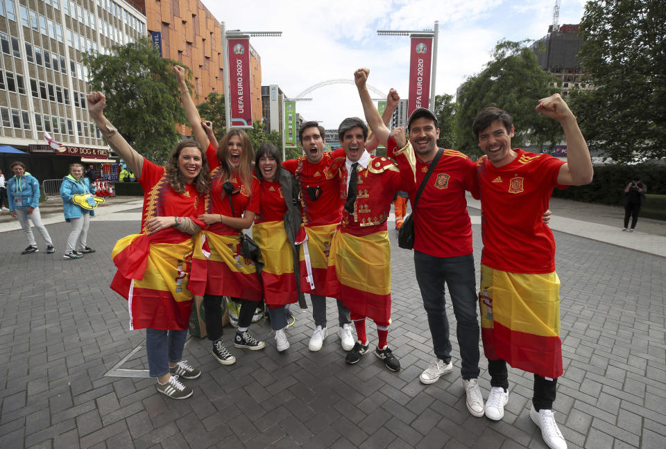 Spanish fans pose for a photo on Wembley Way, prior to the Euro 2020 soccer championship semifinal match against Italy, at Wembley Stadium, in London, Tuesday July 6, 2021. (Nick Potts/PA via AP)