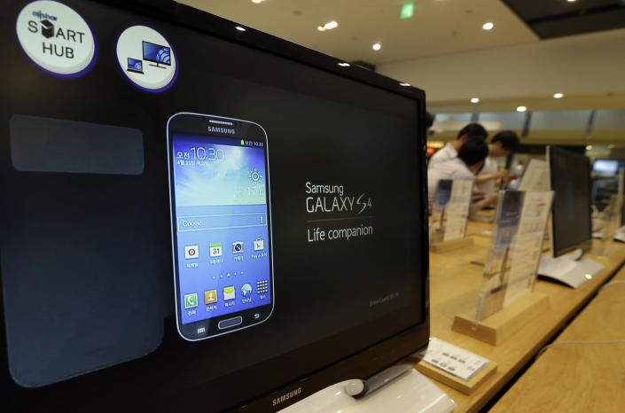 A picture of Samsung Electronics' Galaxy S4 smartphone is seen on the screen at a showroom of its headquarters in Seoul, South Korea, Friday, July 5, 2013. Even after setting a record high profit, Samsung Electronics disappointed investors who increasingly doubt its mainstay smartphone business can maintain rapid growth. Samsung Electronics Co. on Friday estimated its April-June operating profit at a record high of 9.5 trillion won ($8.3 billion). But it fell short of forecasts by analysts who held higher expectation for the world's largest smartphone maker. (AP Photo/Lee Jin-man)