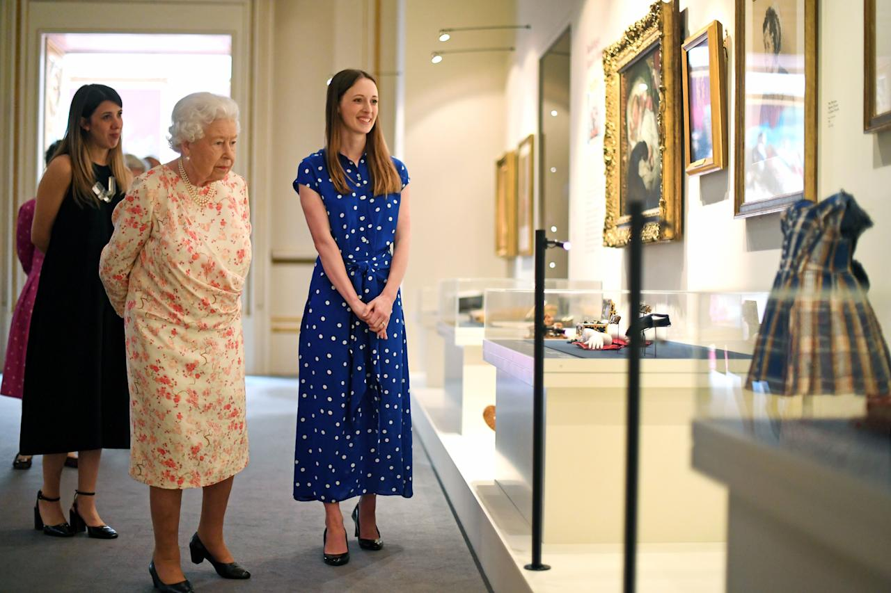 """<p>This summer, <a href=""""http://www.townandcountrymag.com/society/tradition/a28421535/buckingham-palace-queen-victoria-exhibit-summer-2019-first-look/"""" target=""""_blank"""">a new exhibition on Queen Victoria will open at Buckingham Palace</a>, highlighting how the British monarch transformed the royal residence. Today, Queen Elizabeth went to preview the exhibit on her great-great grandmother with her son, the Duke of York. See all the photos of her touring the displays right below, and if you'd like to see the exhibit yourself, it opens July 20, and will run through September 29 of this year. For more information, visit the <a href=""""https://www.rct.uk/visit/the-state-rooms-buckingham-palace"""" target=""""_blank"""">Royal Collection Trust's website</a>.</p>"""