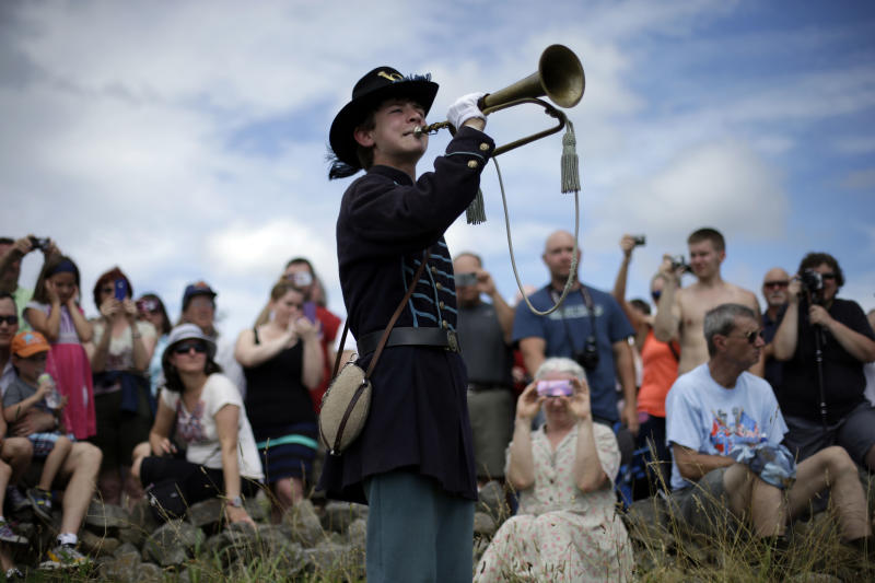 Alan Tolbert, 15, of Shippensburg Pa., plays Taps at Gettysburg National Military Park at the end of a commemorative march where Pickett's Charge took place during ongoing activities commemorating the 150th anniversary of the Battle of Gettysburg, Wednesday, July 3, 2013, in Gettysburg, Pa. Union forces turned away a Confederate advance in the pivotal battle of the Civil War fought July 1-3, 1863, which was also the war's bloodiest conflict with more than 51,000 casualties. (AP Photo/Matt Rourke)